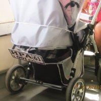Детская коляска с номерной табличкой в автобусе и... мамины коленки :: татьяна