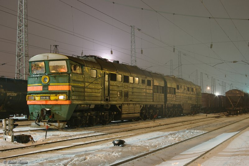 Diesel locomotive 2TE116-503 with train on Likhaya